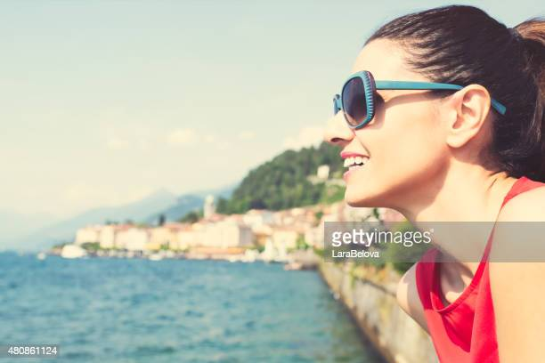 Middle aged woman enjoying view at lake Como, Italy