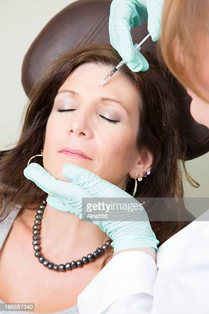 Middle aged woman getting botox treatment at the medical spa