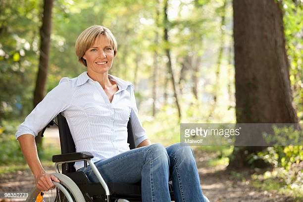 middle aged woman in a wheelchair - spinal cord injury stock photos and pictures