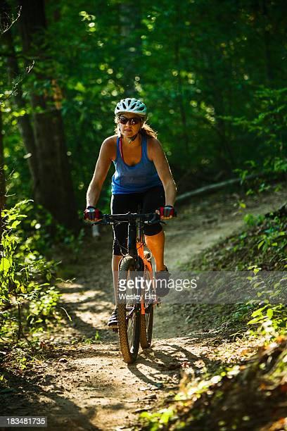 middle aged woman mountain biker - ファイアットヴィル ストックフォトと画像