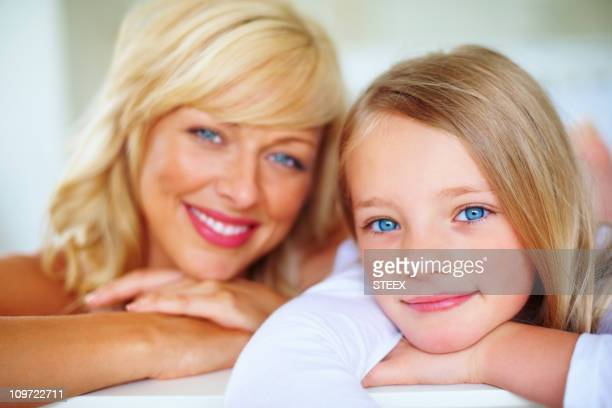 middle aged woman smiling with her daughter - petite young models stock photos and pictures
