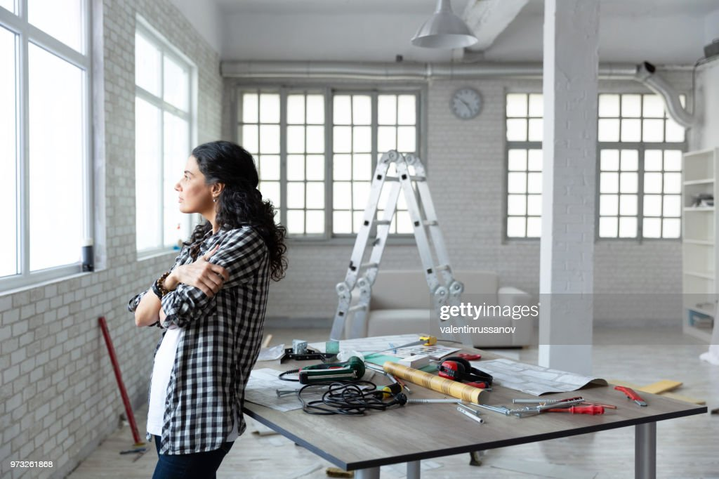 Middle aged woman standing in new home : Stock Photo