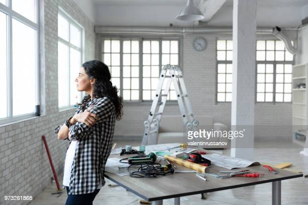 middle aged woman standing in new home - depresion stock pictures, royalty-free photos & images