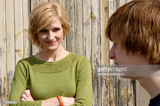 middle aged woman teen son portrait