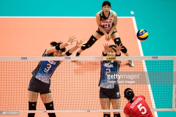 Middle blocker Nana Iwasaka of Japan and Wing spiker Sarina Koga of Japan blocks during the FIVB Volleyball World Grand Prix match between Japan vs...
