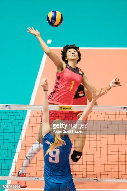 Middle blocker Xinyue Yuan of China spikes the ball during the FIVB Volleyball World Grand Prix match between China vs Serbia on July 23 2017 in Hong...