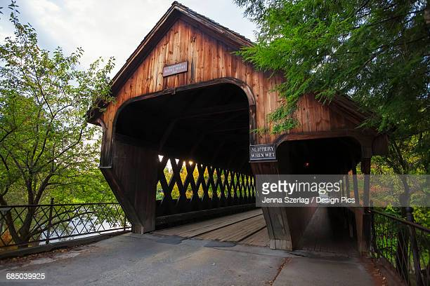 middle bridge - covered bridge stock photos and pictures