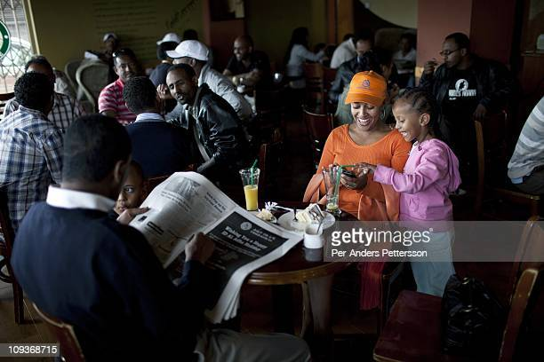 A middle class family have coffee and cake at Kaldis a on November 14 2010 in Addis Ababa Ethiopia There's a big cafe culture in Addis and the many...