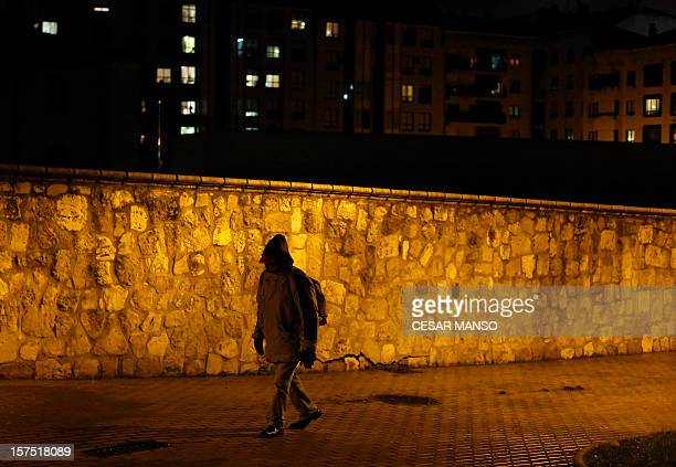 """Middle class to underclass in impoverished Spain"""" A homeless man walks to the Caritas charity shelter in Burgos, northern Spain, on November 28,..."""