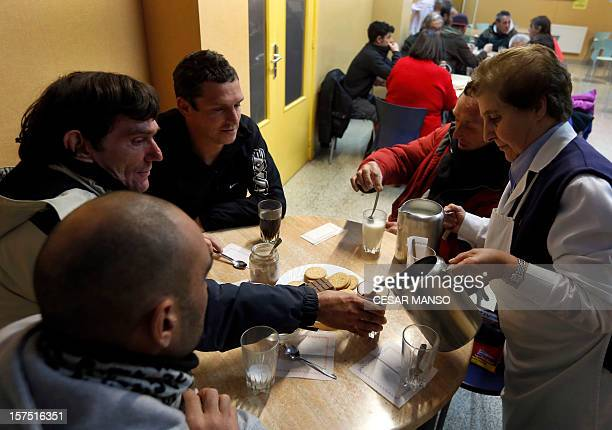 "Middle class to underclass in impoverished Spain"" Homeless peopledrink coffee at the Caritas charity shelter in Burgos, northern Spain, on November..."