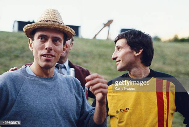 Middle distance runners Steve Ovett and Sebastian Coe share a joke circa 1984.