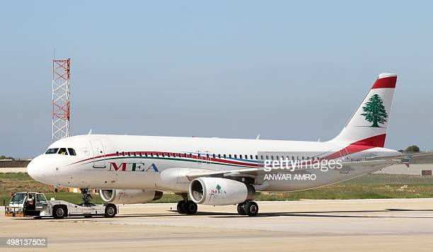 Middle East Airlines' plane is taxied on the tarmac at Rafik Hariri international airport in the Lebanese capital, Beirut, on November 21, 2015....