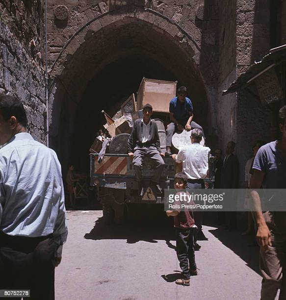 Middle East June 1967 Six Day War Jerusalem Israel Palestinian Arab families moving their belongings out of the Jewish Quarter of the Old City of...