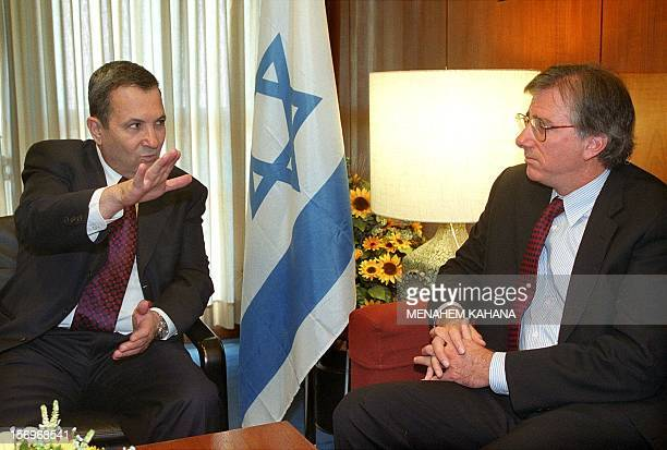 US Middle East peace envoy Dennis Ross listens to Israeli Prime Minister Ehud Barak during their meeting 27 October 1999 in Jerusalem Ross said that...
