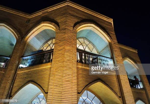 middle east silk road palace lit up at night - vogel stock pictures, royalty-free photos & images