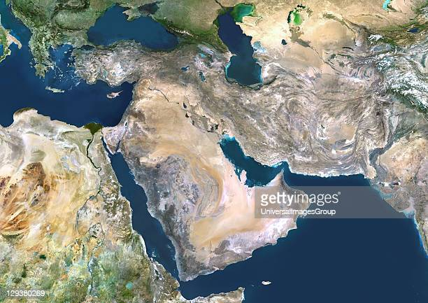 Middle East true colour satellite image North is at top Vegetation is green water is dark blue and bare ground mostly desert is yellowbrown At centre...