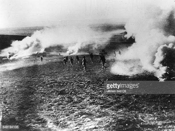 Middle East War Israeli soldiers invading Egyptian territory in an assault with smoke grenades- November 1956