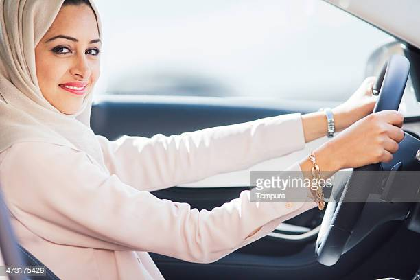 Middle easter woman driving a luxury car in Dubai