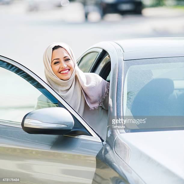 Middle easter woman entering a luxury car in Dubai