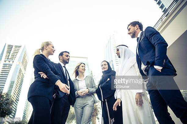 Middle Eastern Business Men Talking with Foreign Expats