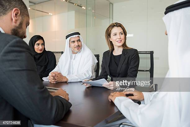 Middle Eastern business people in meeting at office