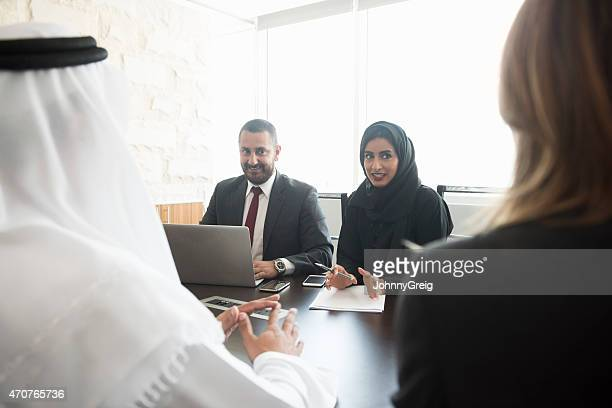 Middle Eastern business people in office meeting