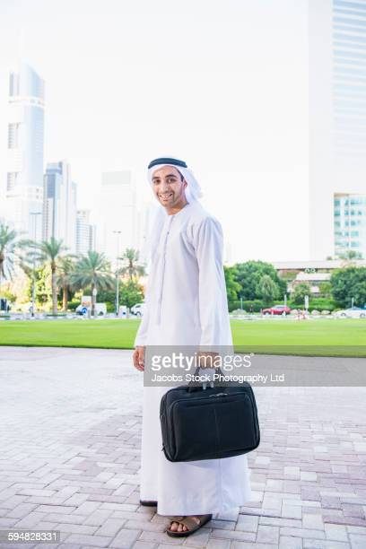 Middle Eastern businessman carrying briefcase
