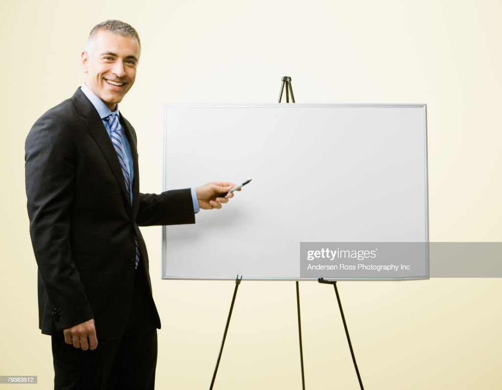 Middle Eastern businessman giving presentation : Stock Photo