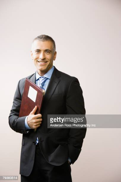 Middle Eastern businessman holding folder