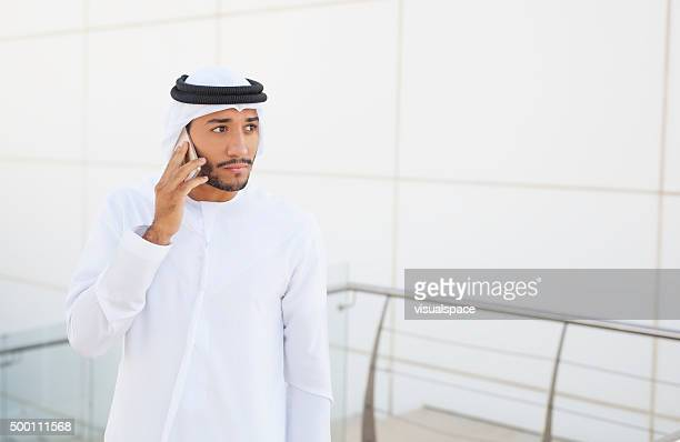 Middle Eastern Businessman On The Phone Outside Office