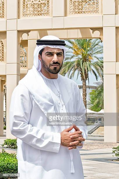 Middle Eastern businessman standing outside on the street