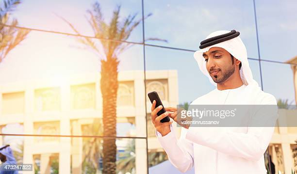 Middle Eastern businessman standing outside