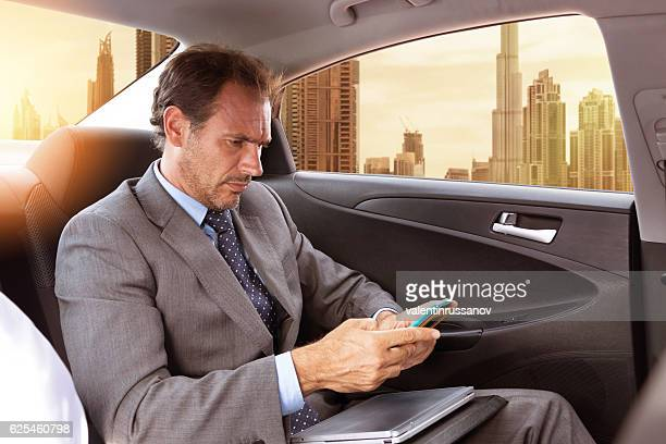 Middle eastern businessman traveling in car