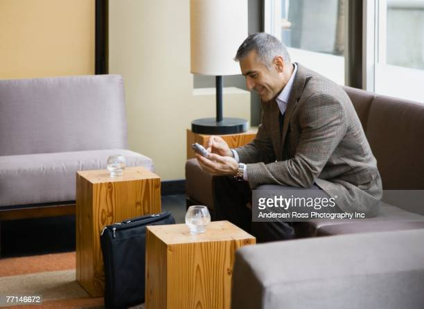 Middle Eastern businessman using electronic organizer