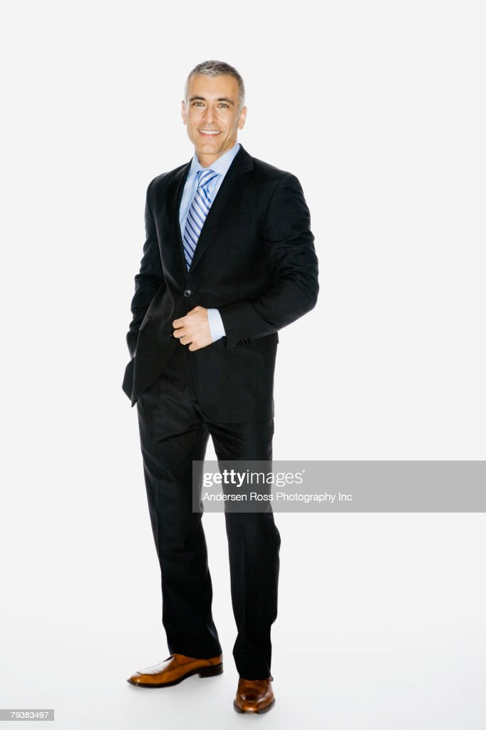 Middle Eastern businessman with hand on jacket button : Stock-Foto
