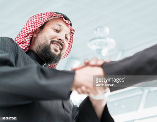 Middle Eastern businessmen closing the deal