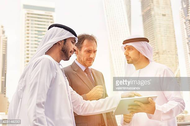 Middle eastern businessmen meeting western man