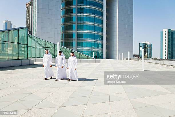Middle eastern businessmen on a skyscraper