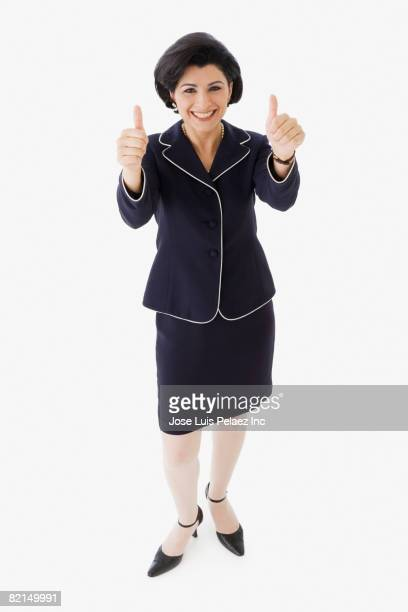 Middle Eastern businesswoman giving thumbs up