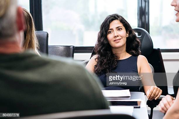 Middle Eastern businesswoman in meeting with male colleague