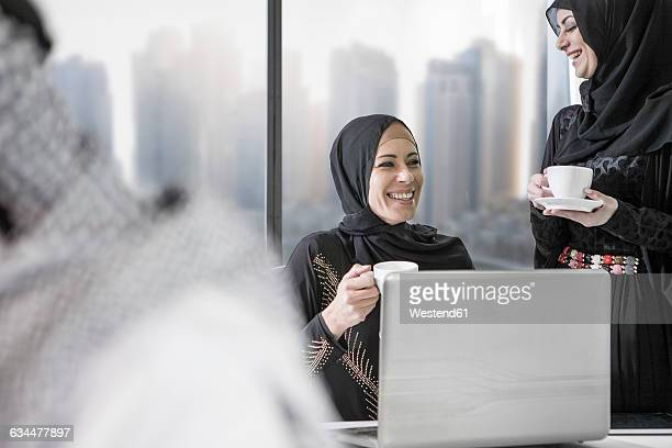 middle eastern businesswoman in office - traditional clothing stock pictures, royalty-free photos & images