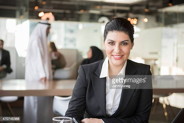 Middle Eastern businesswoman smiling in office