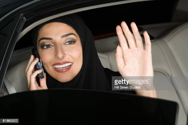 middle eastern businesswoman talking on cell phone - human body part stock pictures, royalty-free photos & images
