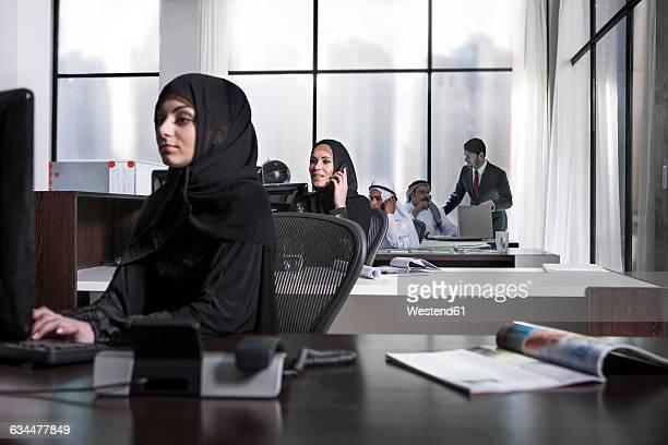 Middle Eastern businesswomen working in office