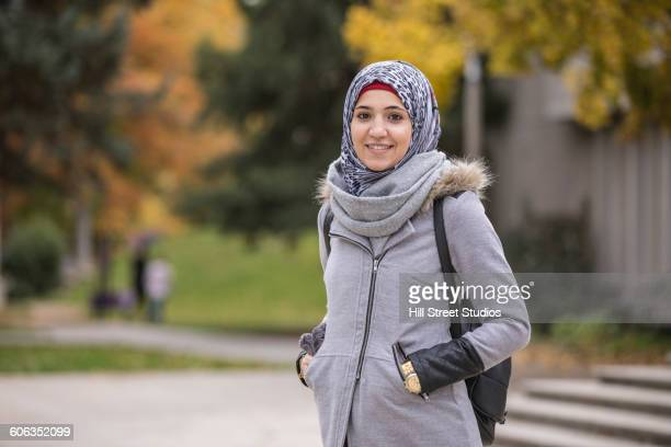 Middle Eastern college student smiling on campus