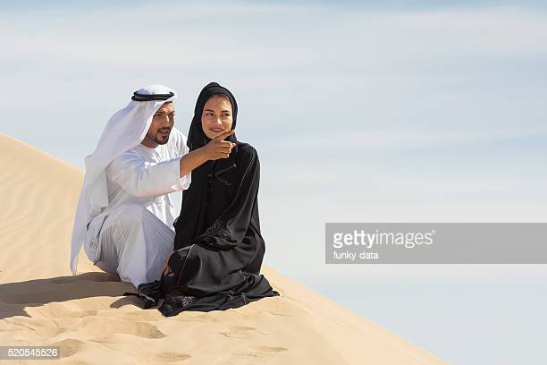 Middle Eastern couple in the desert