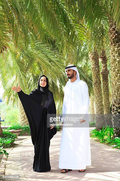 Middle Eastern couple walking on trail in the park