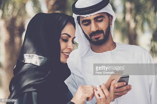 Middle Eastern couple with smart phones