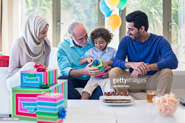 Middle Eastern family celebrating the kid's birthday