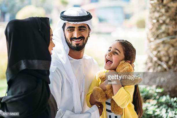 Middle Eastern Family having fun outdoors.